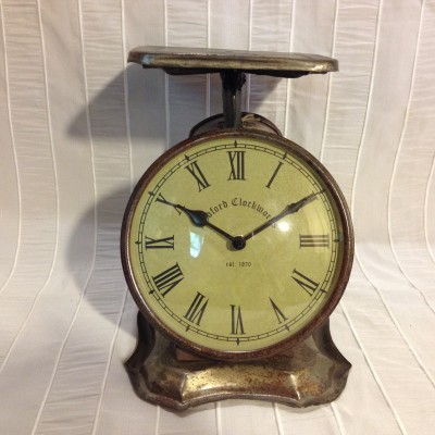 Horloge balance bronze antique